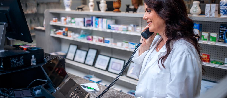 woman on landline pharmacy
