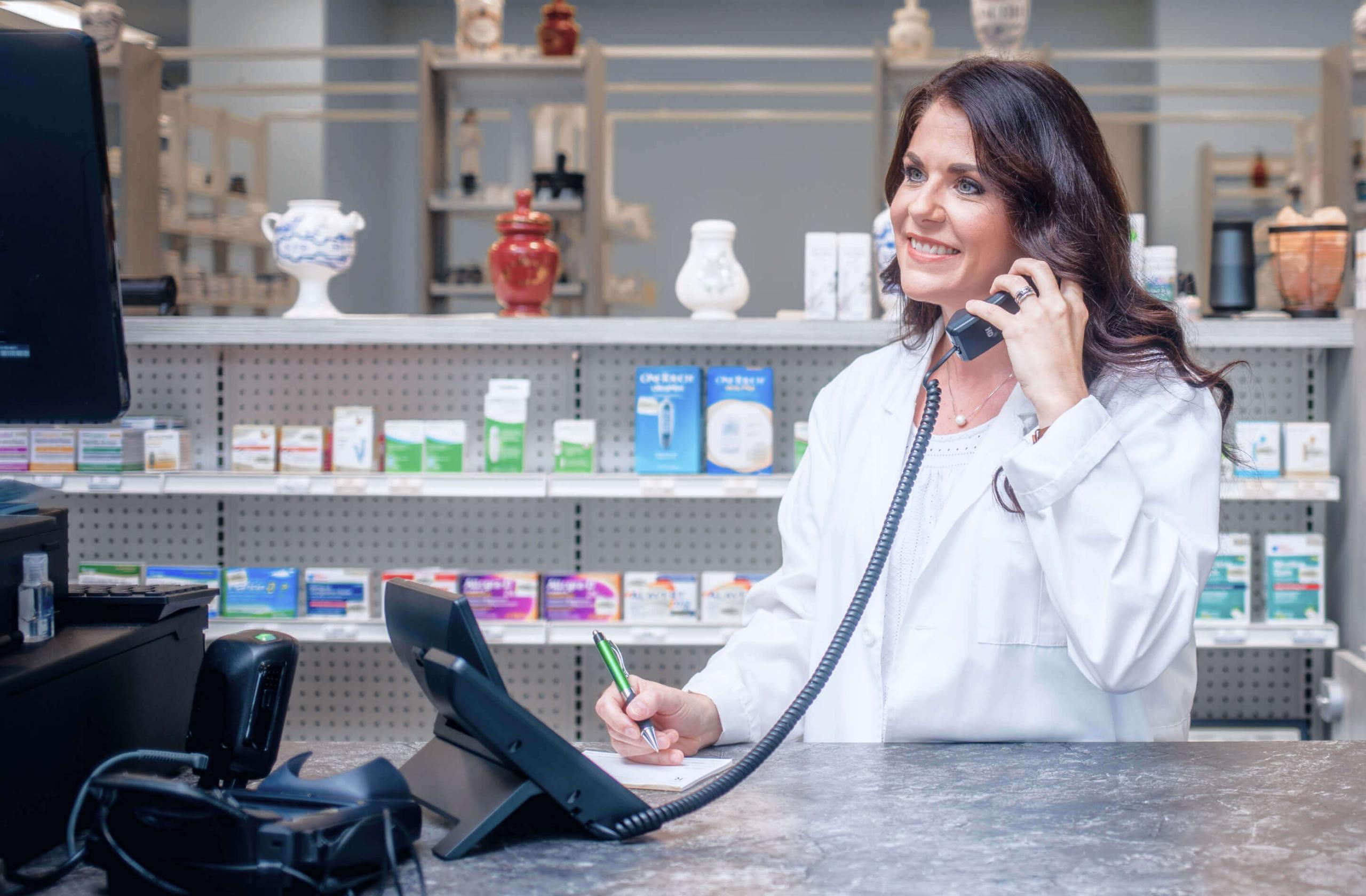 woman on phone in pharmacy